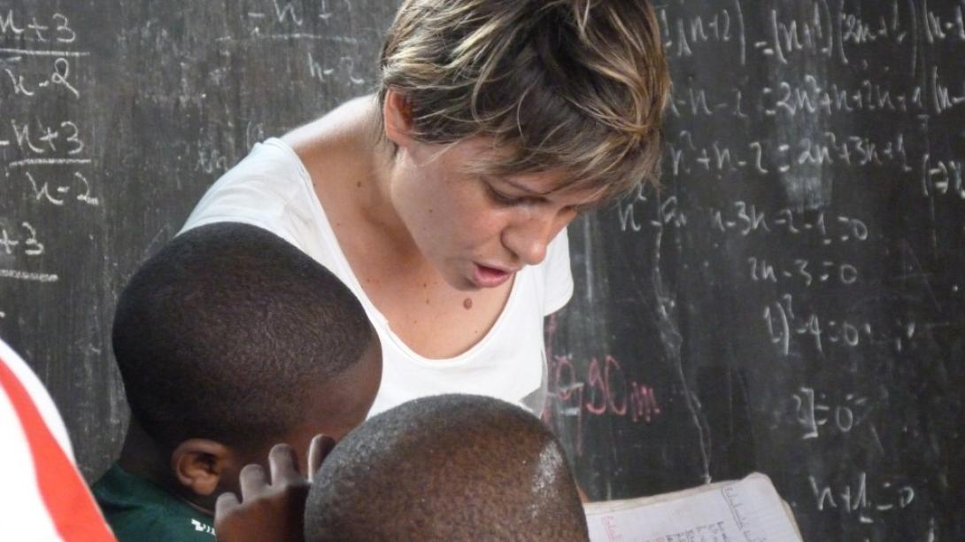 A volunteer reading to children in Togo